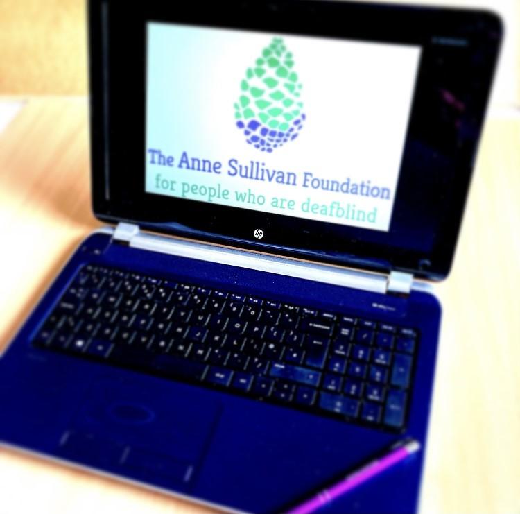 Blue laptop displaying ASF logo on screen